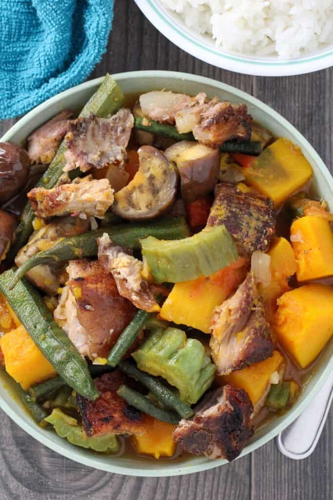 Pinakbet with Crispy Lechon in a white serving bowl