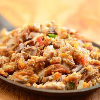 Crispy Sisig is the perfect use for your leftover lechon kawali! A delicious medley of tangy, spicy and crispy, it's great for family dinner meals as well as a party appetizer.