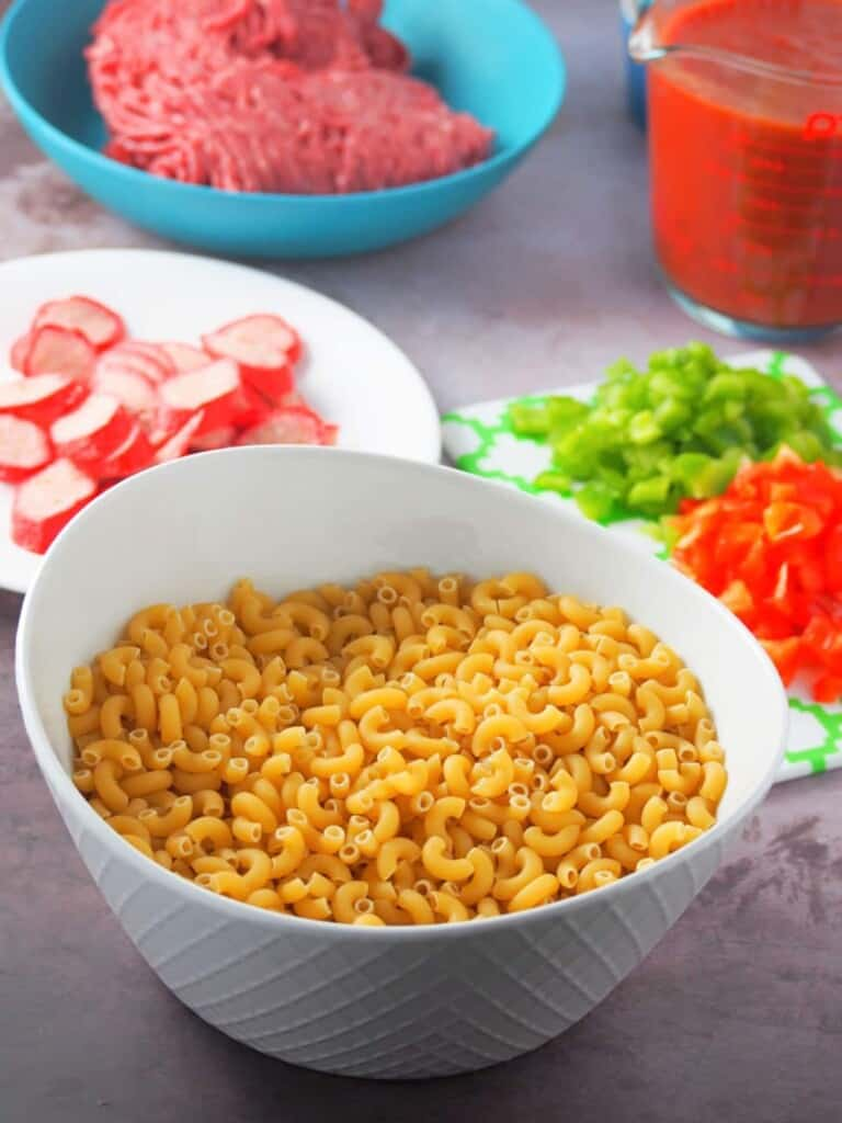 elbow macaroni, sliced hot dogs, ground beef, spaghetti sauce, diced bell peppers