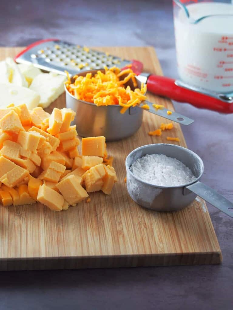 cheese cubes, shredded cheese, flour, milk