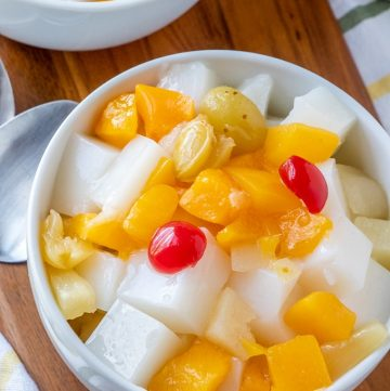 almond tofu with fruit cocktail in a white bowl