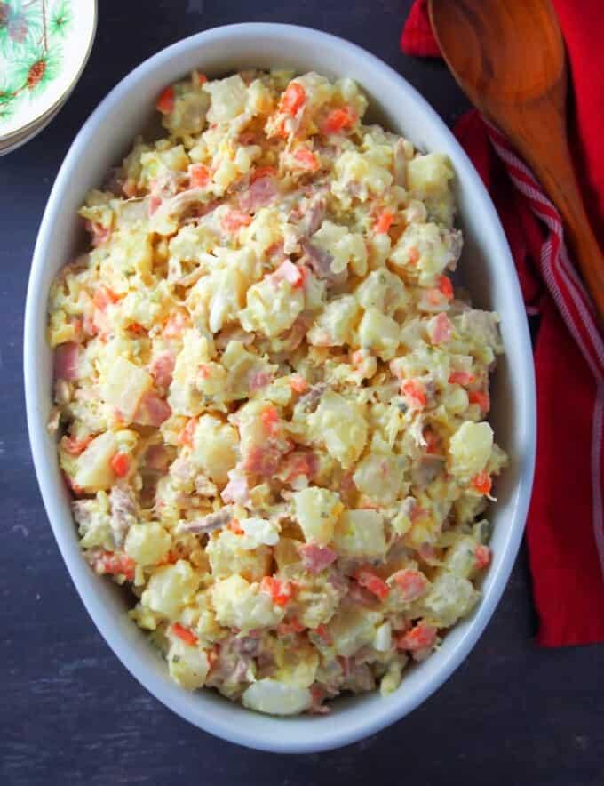 Filipino-style potato salad in a white casserole dish