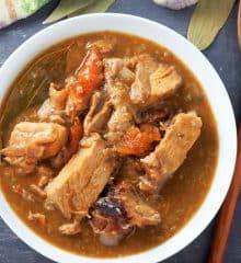 Paksiw na Lechon in a white serving bowl
