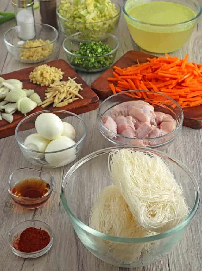 chicken wings, cellophane noodles, chopped onion, minced garlic, julienned carrots, hardboiled eggs