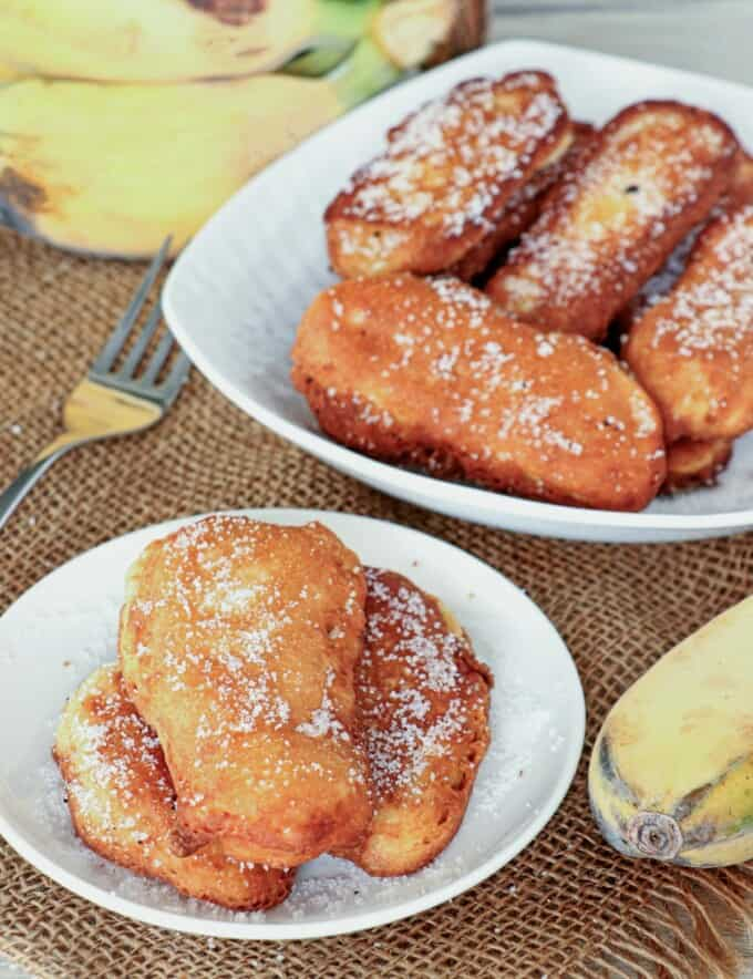 banana fritters on white plates