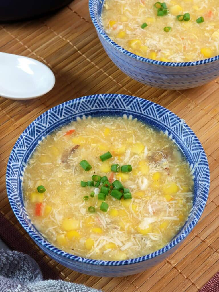 creamy corn crab soup in blue bowls