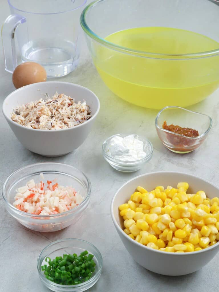 lump crab meat, imitation crab, corn kernels, chopped green onions, chicken broth, corn starch, seafood base, egg