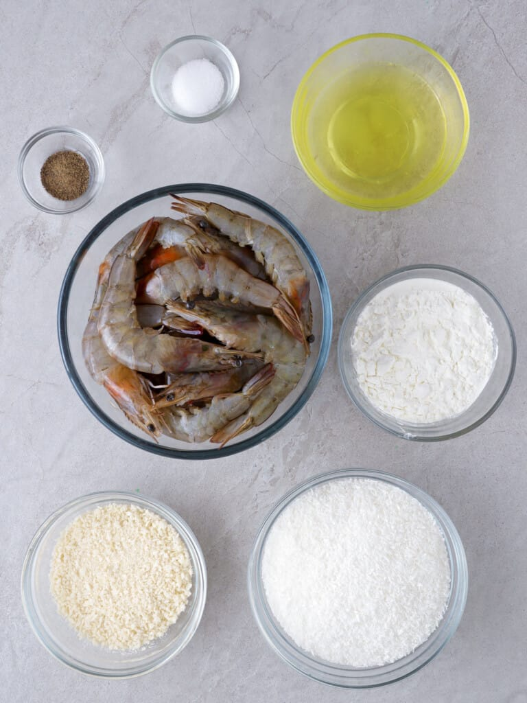 peeled shrimp, cornstarch, sweetened shredded coconut, egg whites, salt, pepper