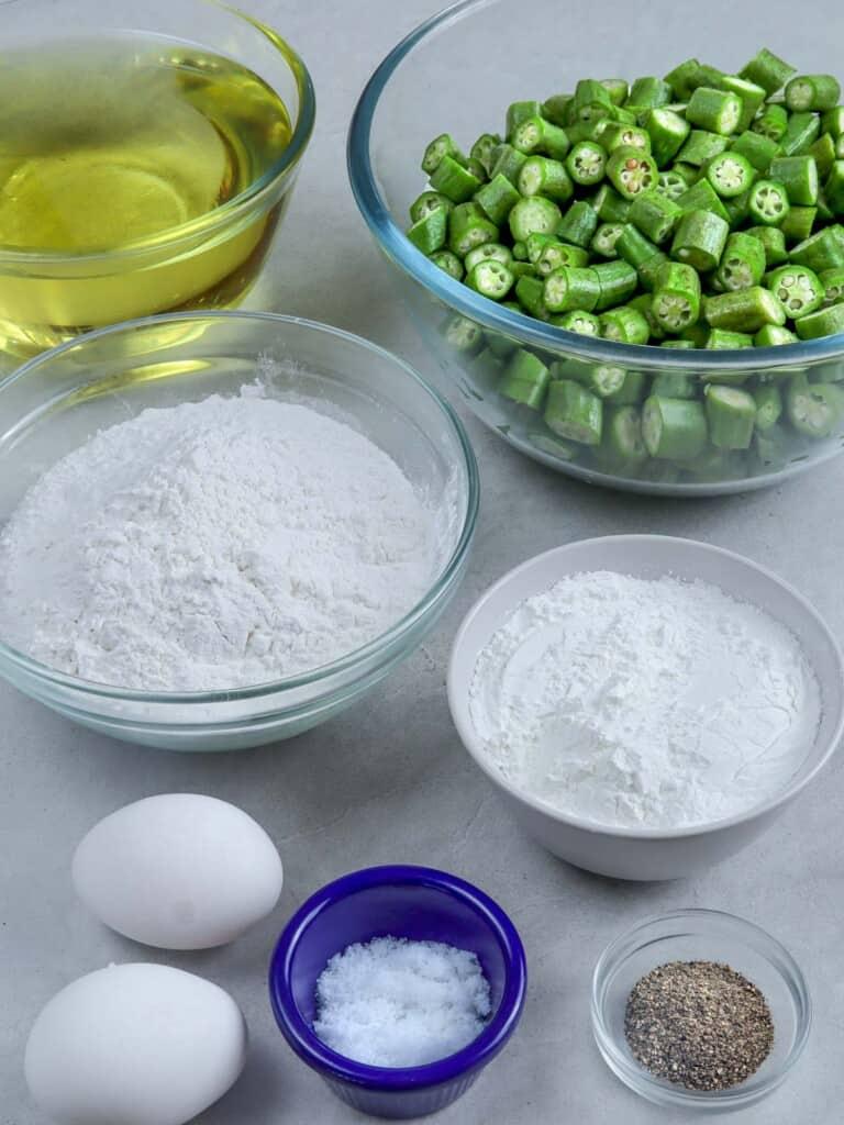 sliced okra, flour, cornstarch, oil, eggs, salt, and pepper