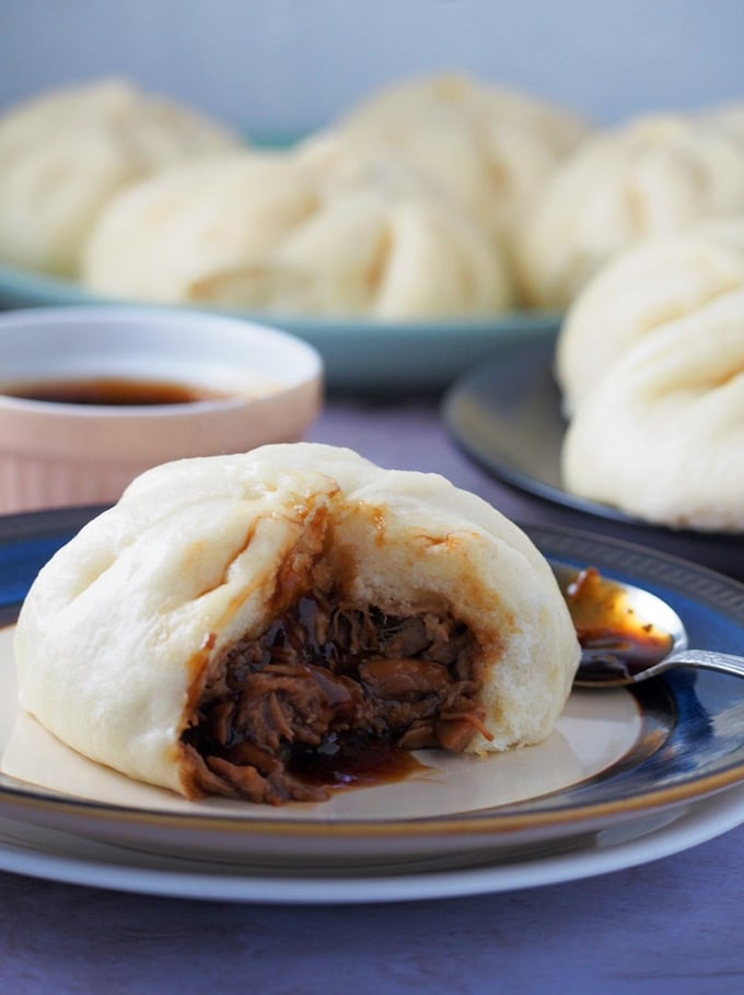 siopao with pork asado filling on a white serving plate