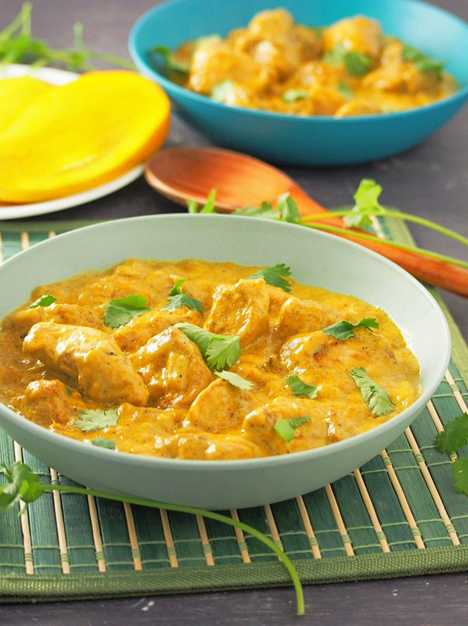 Mango Curry Chicken in a light blue serving bowl