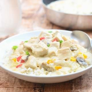 Chicken a la King made with poached chicken, mushrooms, sweet peppers, and heavy cream is a casserole dish the whole family is sure to love. Rich and creamy, it's delicious over rice or pasta.