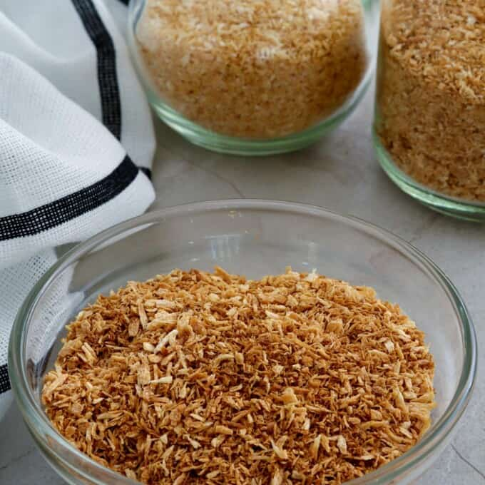 toasted coconut flakes in jars and bowl