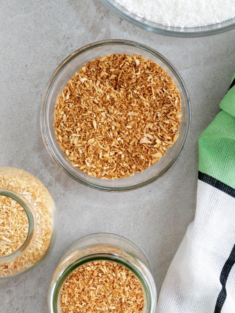 toasted coconut in bowl and jars
