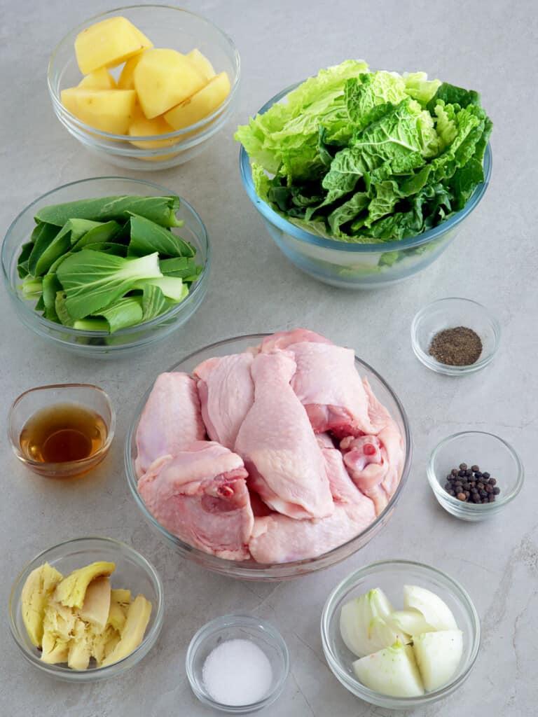 cut-up chicken, julienned ginger, fish sauce, chopped onions, salt, pepper, bok choy, peeled potatoes