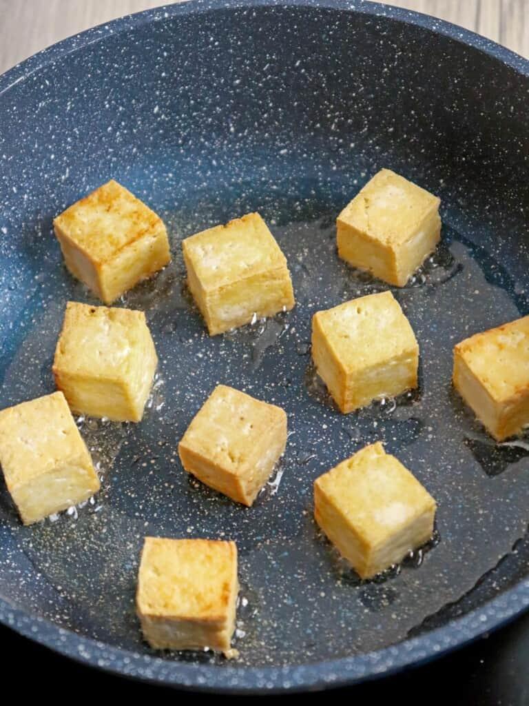 pan-frying tofu in a pan
