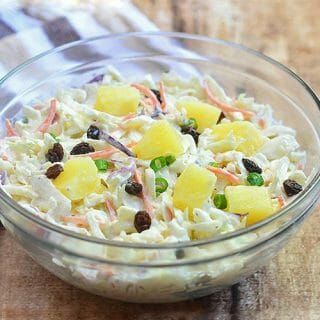 Pineapple Coleslaw in a clear glass serving bowl