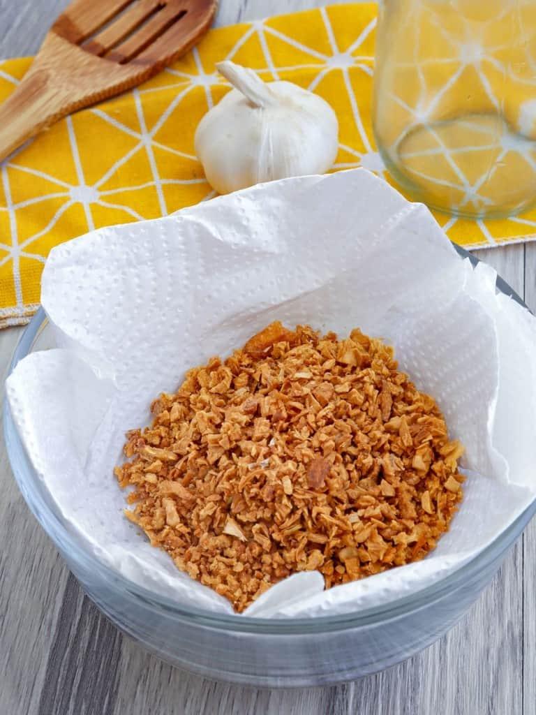 fried garlic bits on paper towels