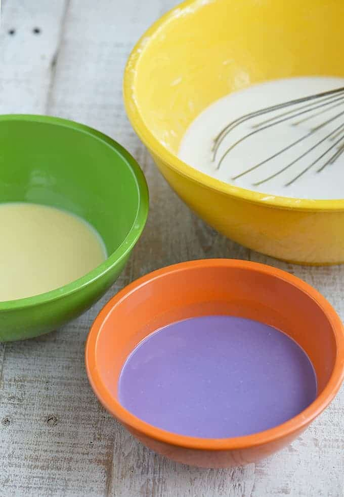 colored glutinous rice batter in three colored bowls to make sapin-sapin