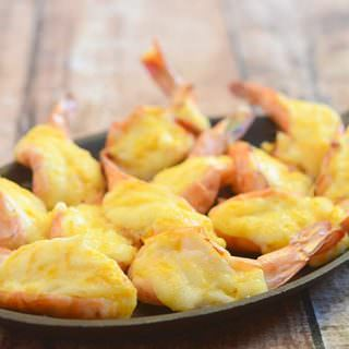 Baked Cheese Shrimp topped with cheese and mayo and then baked until golden and bubbly are sure to be everyone's favorite appetizer! So addicting and delicious, it's hard to stop at one!