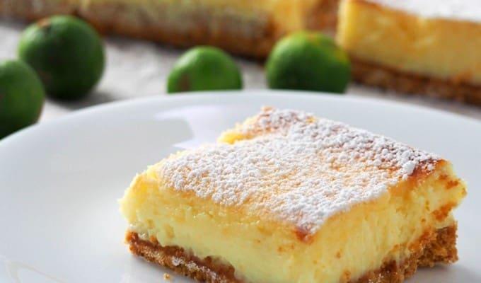 slice of calamansi cheesecake bar on a white plate