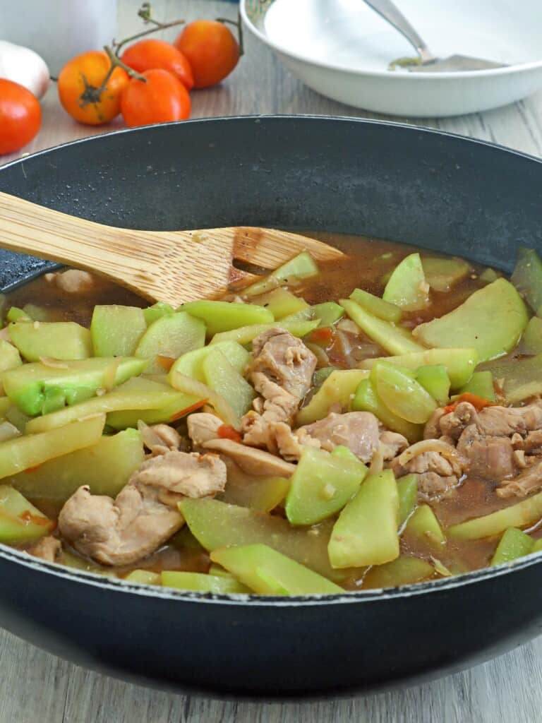 Ginisang Sayote with Chicken in a pan