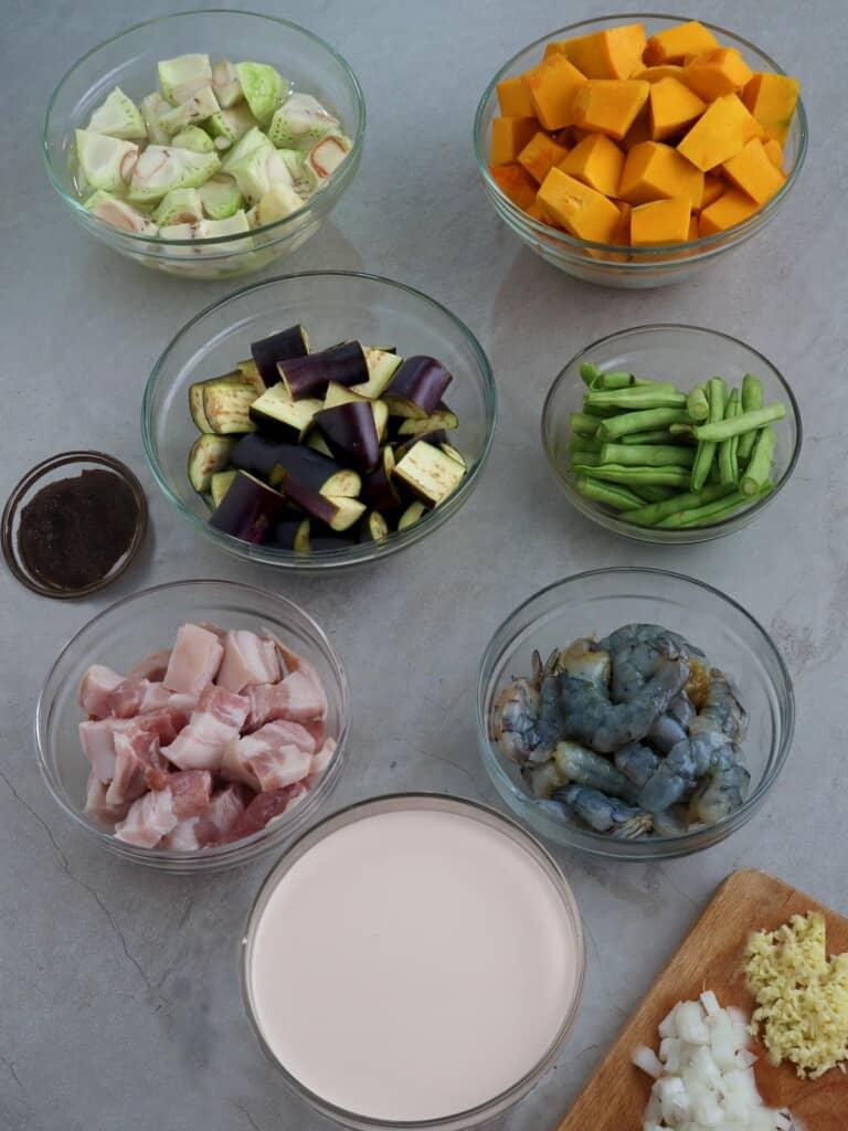 chopped onions, garlic, coconut milk, kalabasa, eggplant, green jackfruit, green beans, shrimp, diced pork