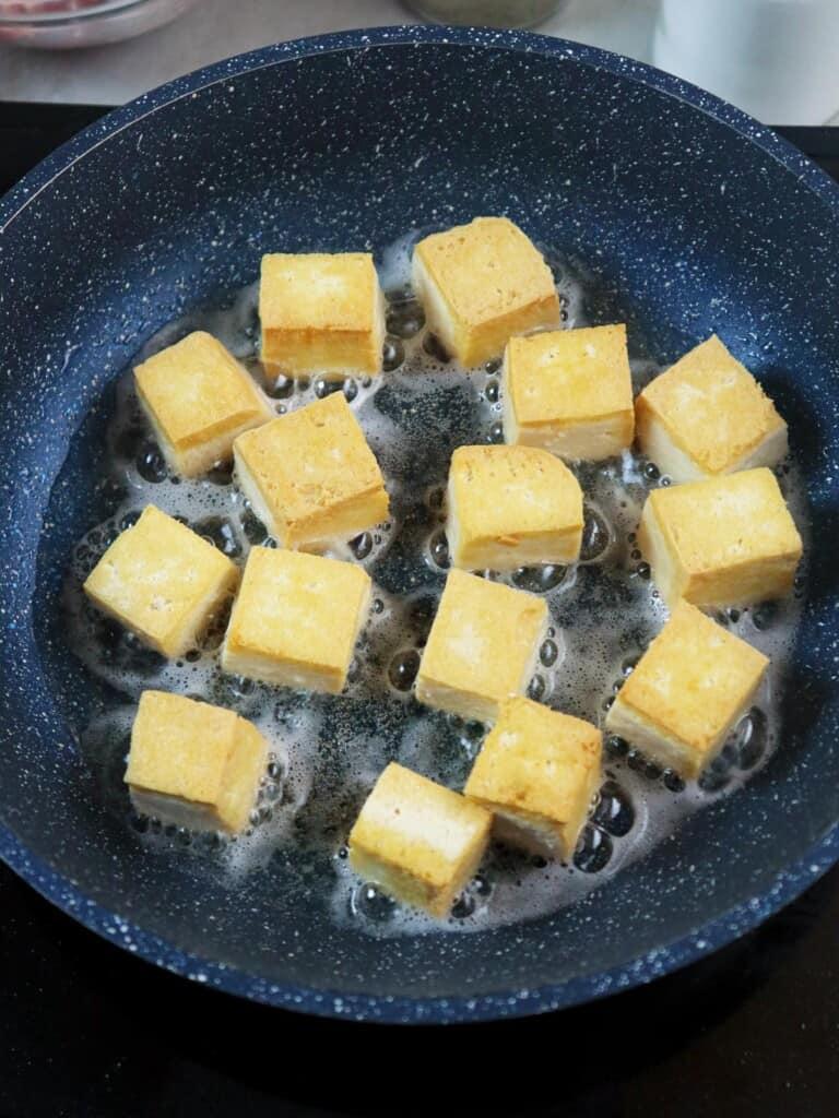 frying tofu in a pan