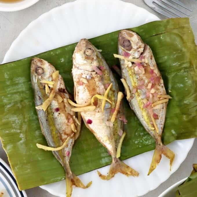 Banana-wrapped Salay-Salay Fish on a white plate