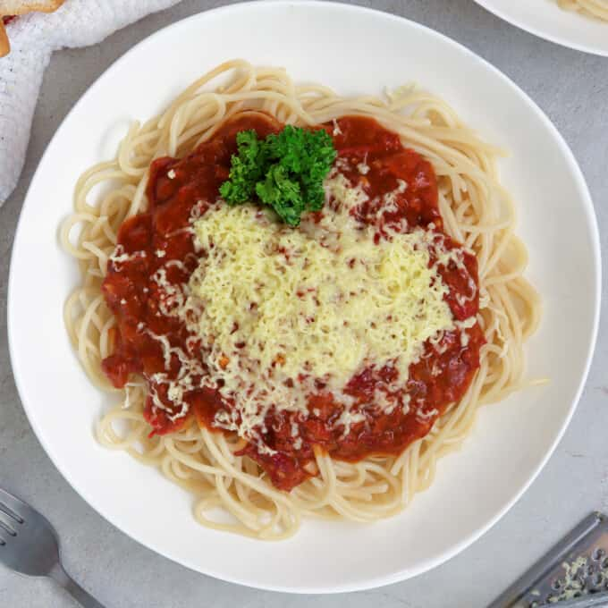 filipino-style spaghetti with corned beef on a white plate