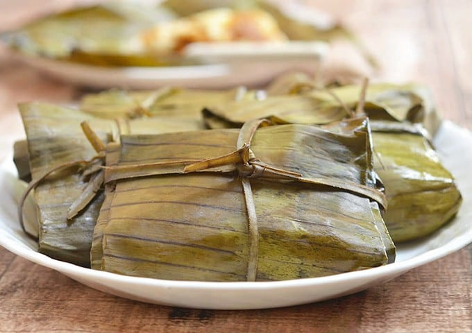 filipino tamales steamed in banana leaves