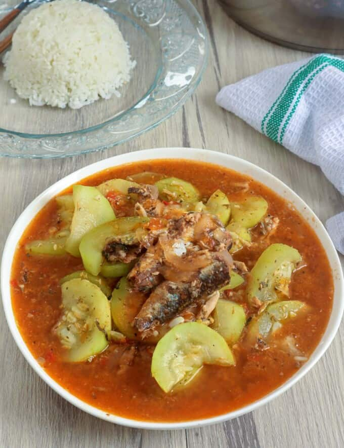 ginisang sardinas with upo in a white serving bowl