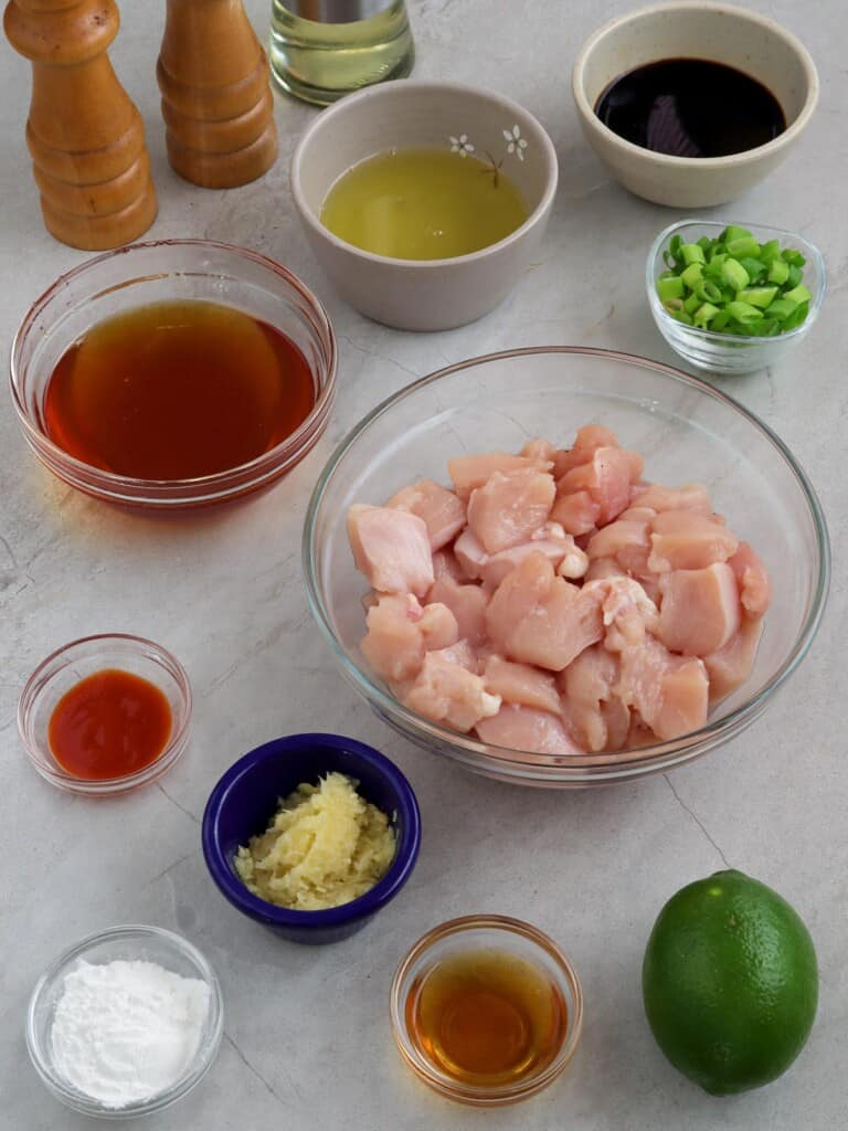 diced chicken breast, honey, lime, garlic, cornstarch, egg whites, Sriracha sauce, green onions, soy sauce in individual bowls