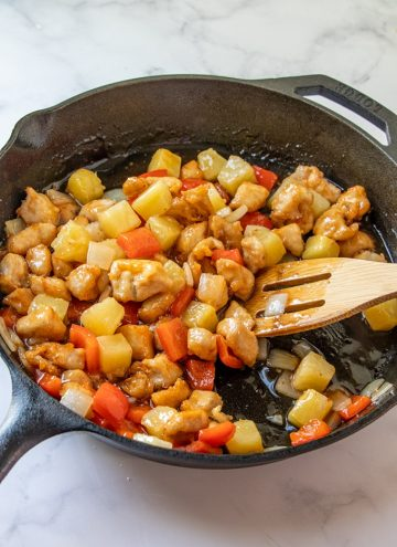 Panda Express Sweet Fire Chicken Copycat in a cast iron skillet