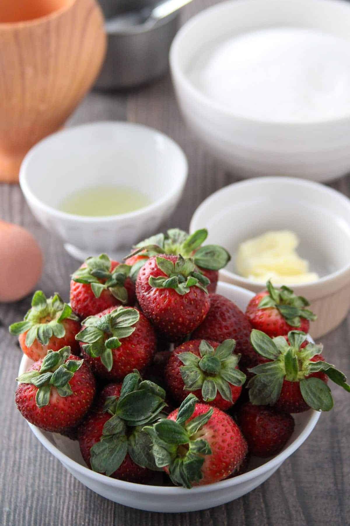 strawberries, sugar, lemon juice, and butter in individual bowls