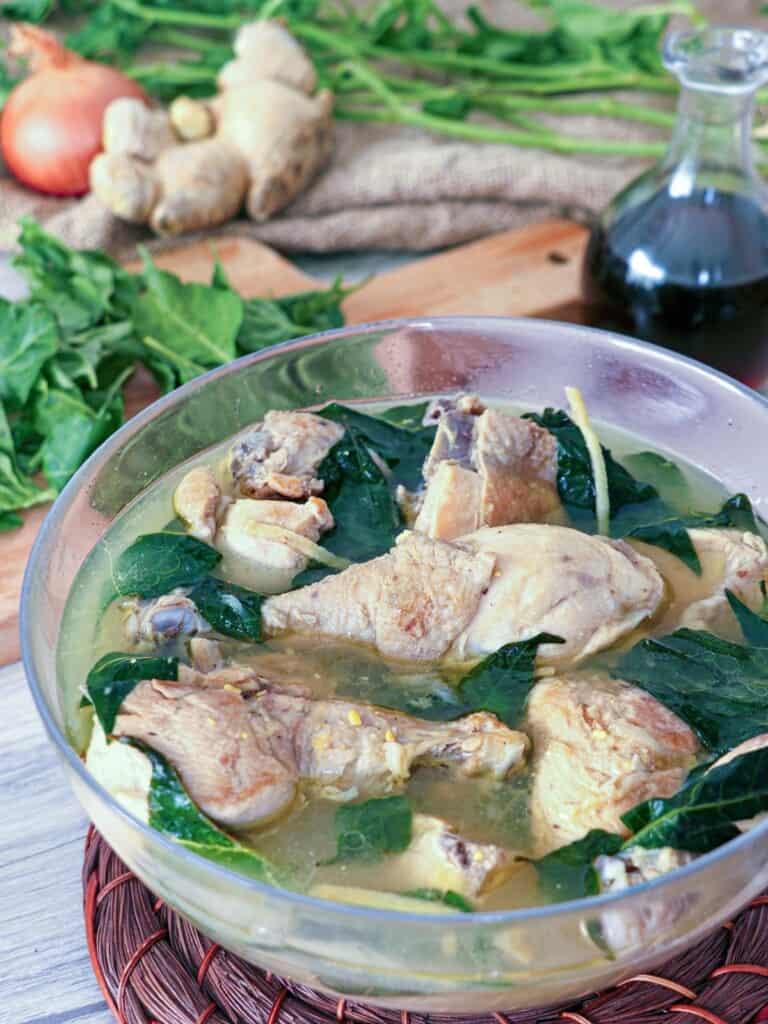 Pinatisang Manok in a glass serving bowl