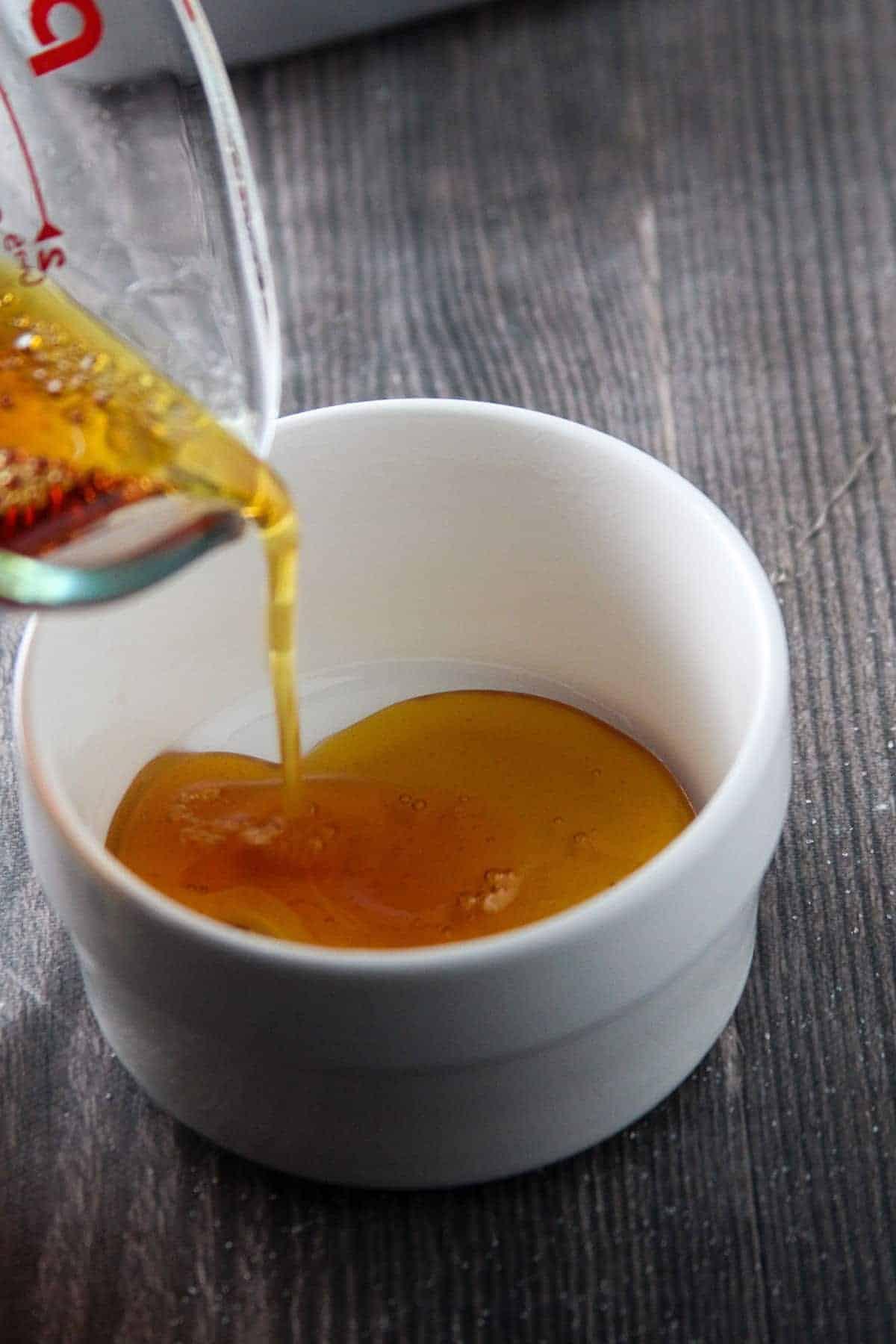 pouring caramel into ramekins
