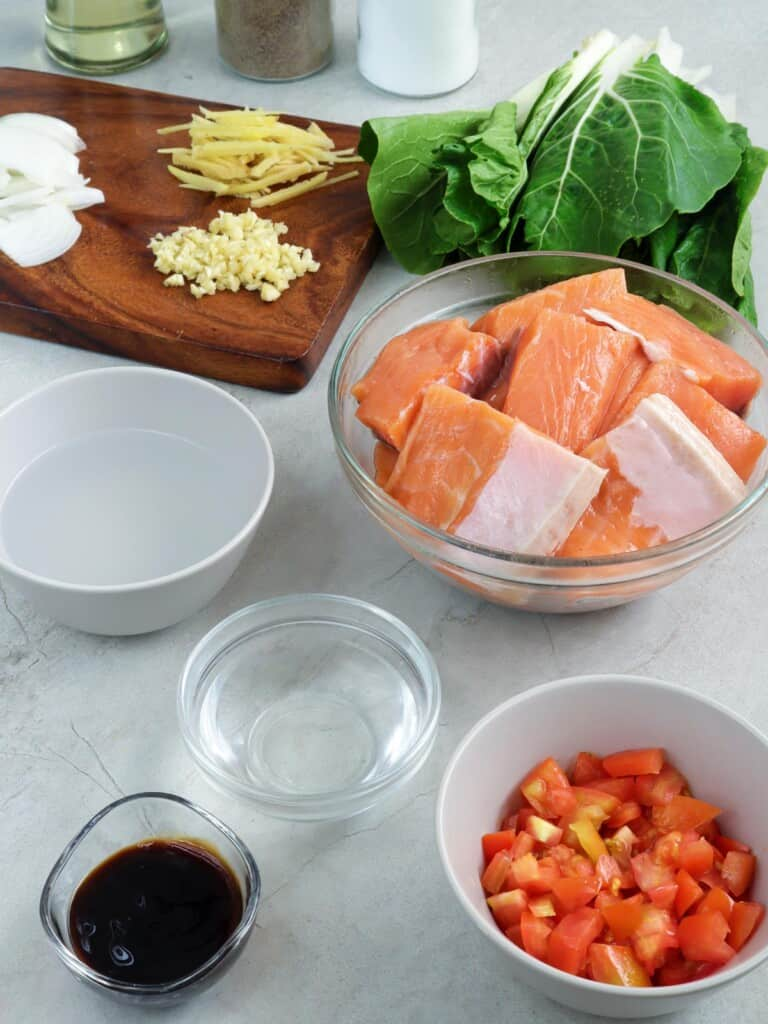 salmon bellies, chopped tomatoes, pechay, vinegar, oyster sauce, ginger, onions, and garlic