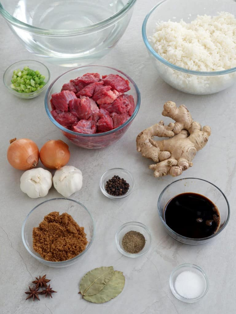 beef cubes, ginger, onions, garlic, brown sugar, soy sauce, water, steamed rice, bay leaves