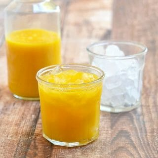 homemade mango nectar in pitcher and clear glasses