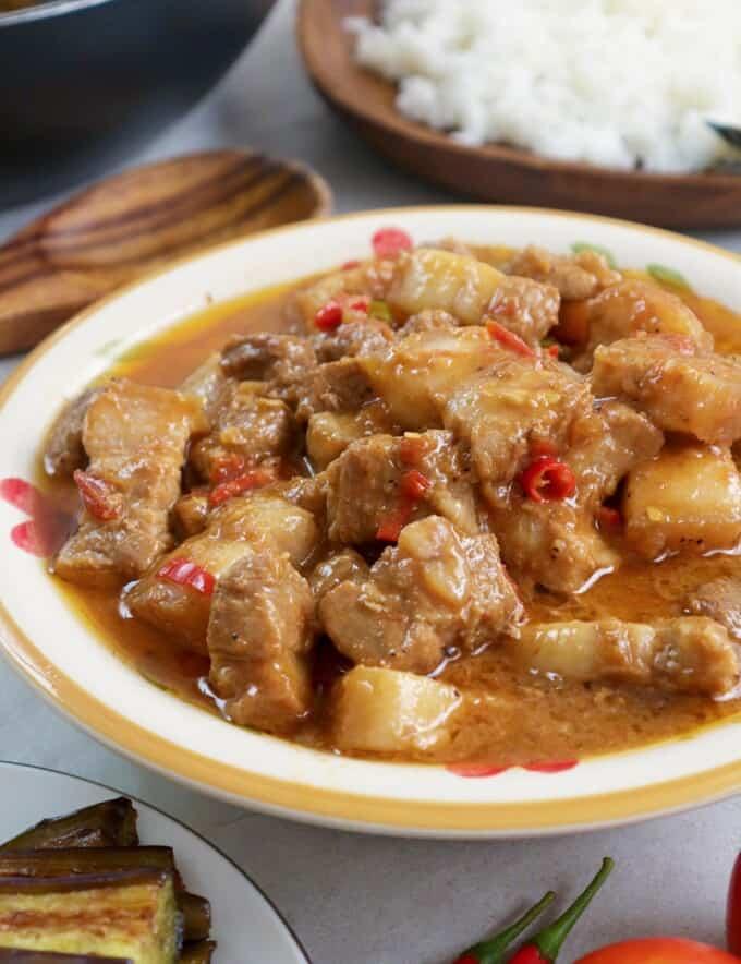 Binagoongan Baboy sa Gata in a white serving bowl