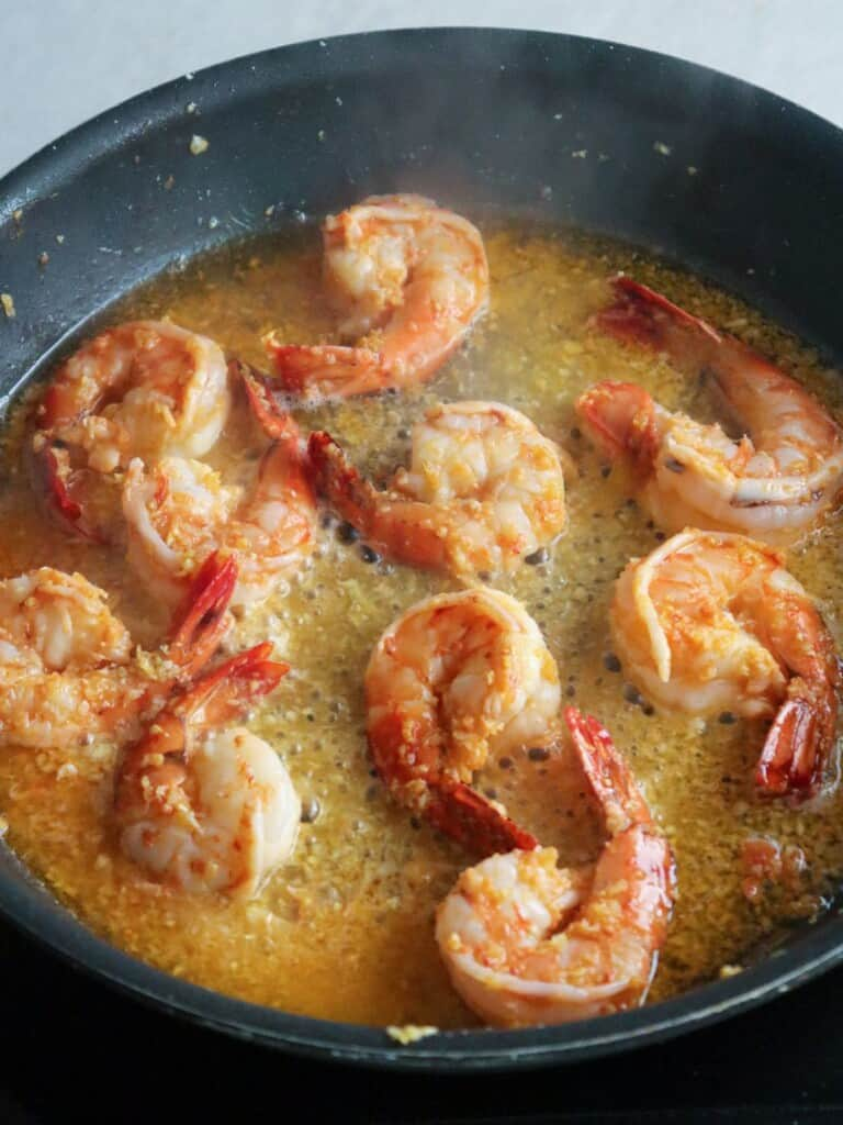 cooking shrimp in a pan