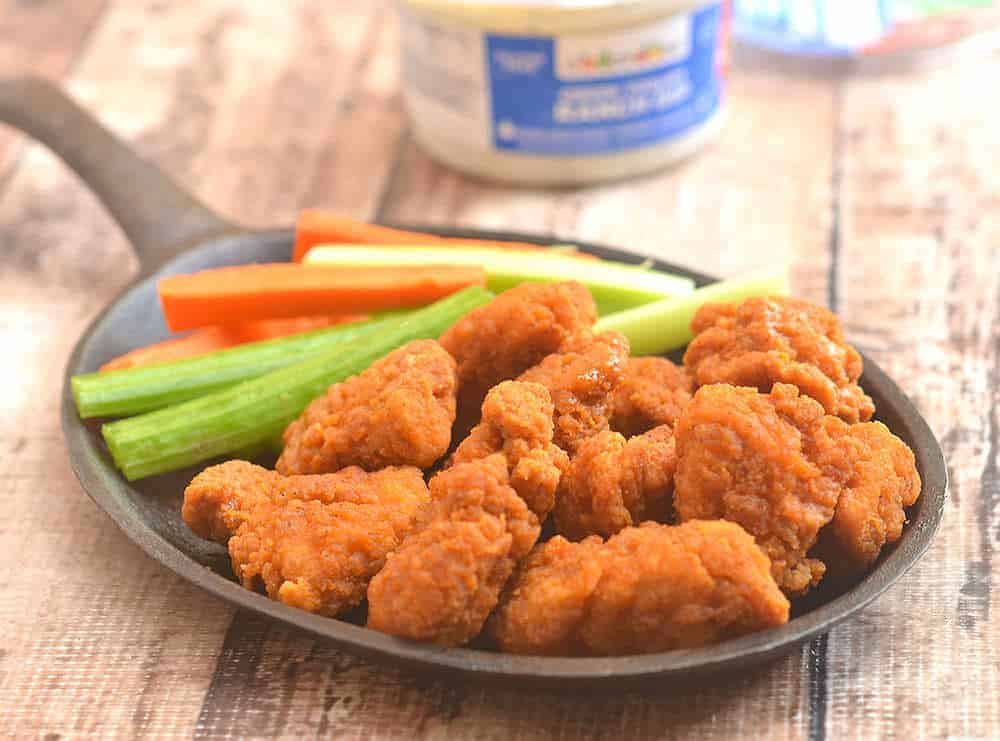 These boneless buffalo wings are fried to perfection and served with fresh veggie sticks.