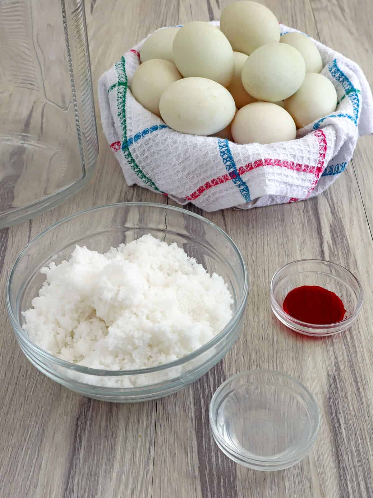 duck eggs, salt, water, vinegar, and red food coloring in individual bowls