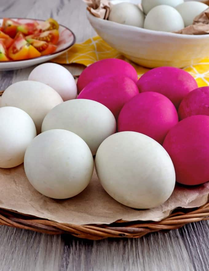 plain and colored salted eggs on a platter