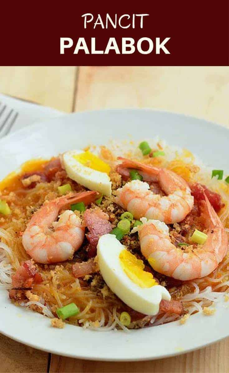 Pancit Palabok is a delicious Filipino noodle dish topped with shrimp gravy, shrimp, smoked fish flakes, pork cracklings, and eggs. Hearty and savory, it's perfect as a light meal or anytime snack.