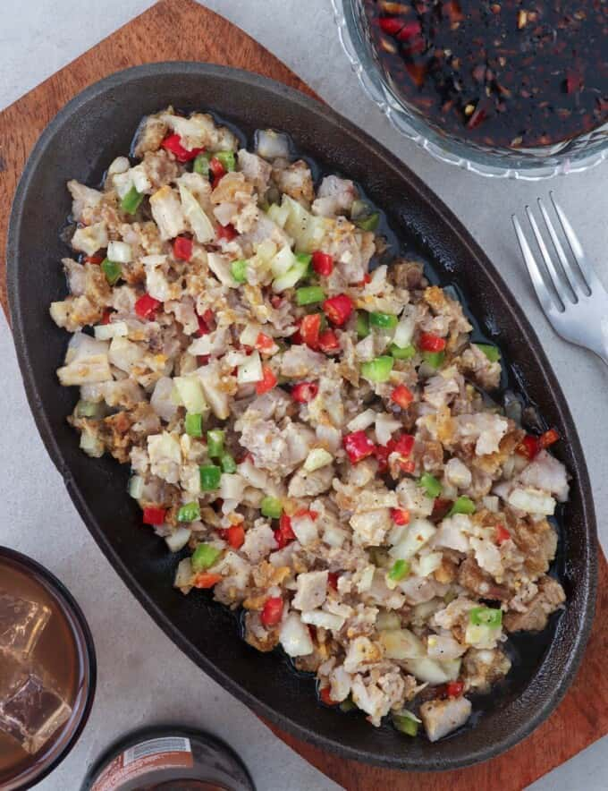 crispy sisig on a sizzling plate