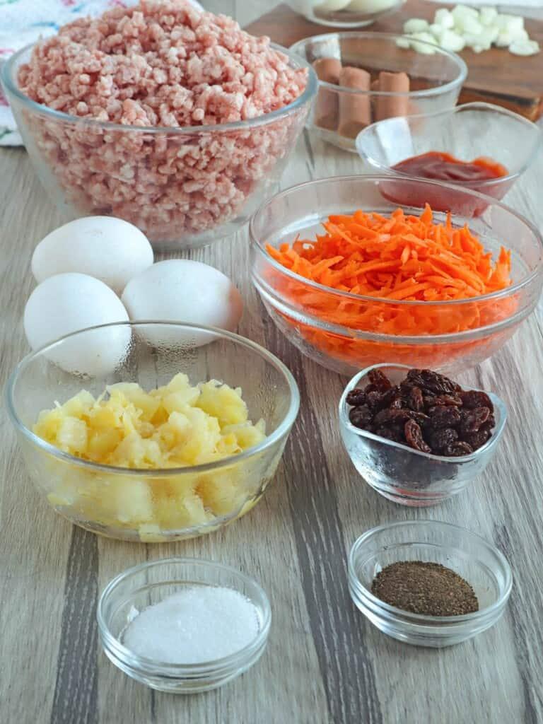 ground pork, shredded carrots, eggs, crushed pineapple, raisins, salt, pepper, banana ketchup, vienna sausages