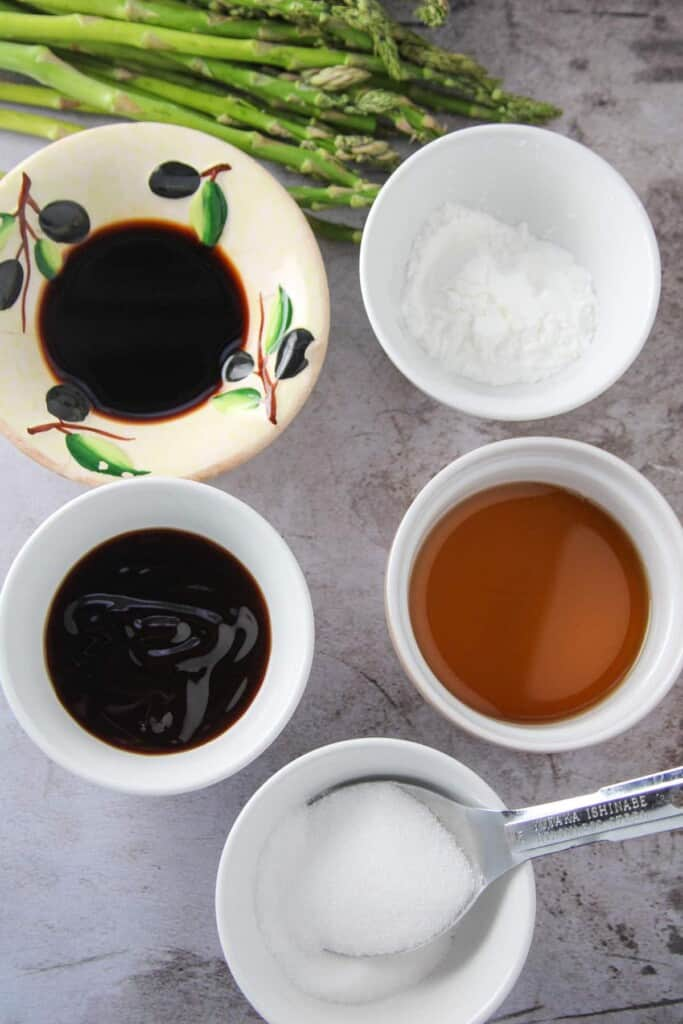 soy sauce, cornstarch, sugar, Chinese cooking wine, oyster sauce in ramekins