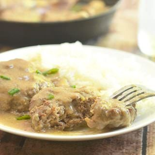 Burger Steak made with beef patties smothered in a rich mushroom gravy. Super moist and flavorful, it's an easy weeknight dinner meal best served with steamed rice or mashed potatoes.